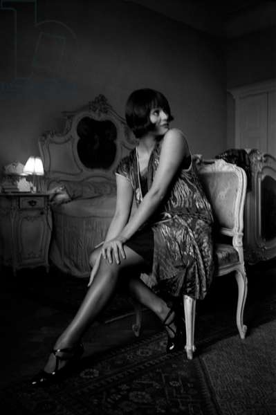 Italian actress Claudia Cardinale (Claude Josèphine Rose Cardinale) sitting in a bedroom on the set of the film Careless, 1961 (b/w photo)