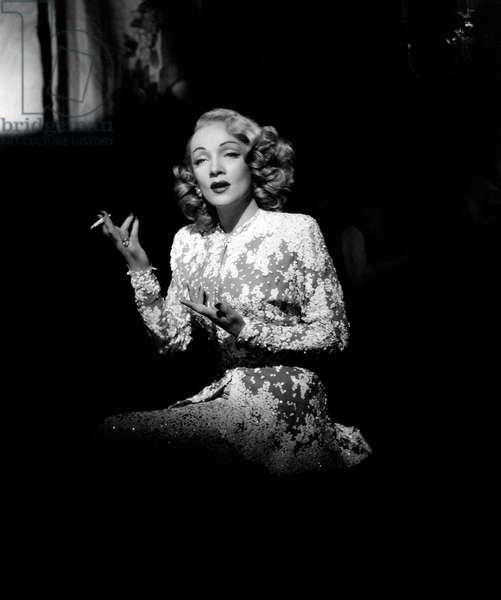 Marlene Dietrich smoking a cigarette, United States