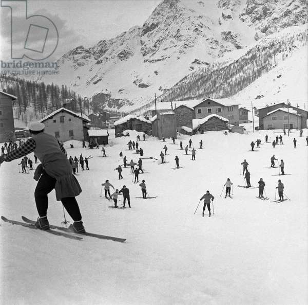 Skiers on holiday in Cervinia, Valtournenche, Italy