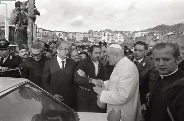 Pope John Paul II shakes hands among a crowd of people, 1980 (b/w photo)