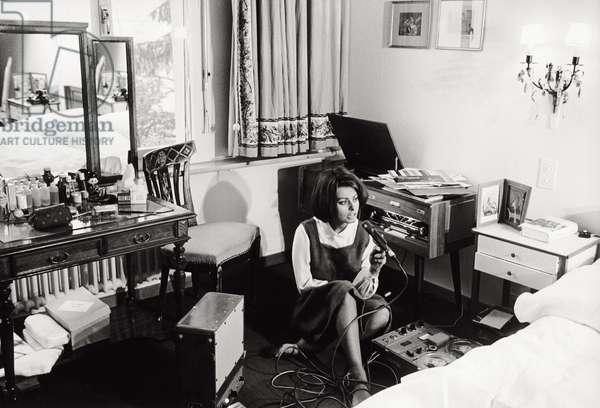 Sophia Loren records her voice as she reads, 1963 (b/w photo)