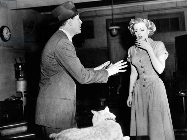 Ray Milland reassures Jan Sterling who is frightened by a cat