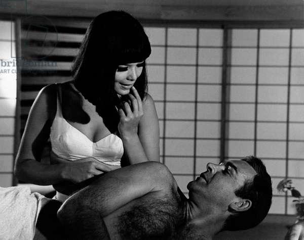 Jeanne Roland is going to massage James Bond, 1966 (b/w photo)