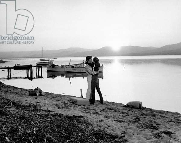 Albert Finney and Audrey Hepburn embracing on the riverside, 1966 (b/w photo)