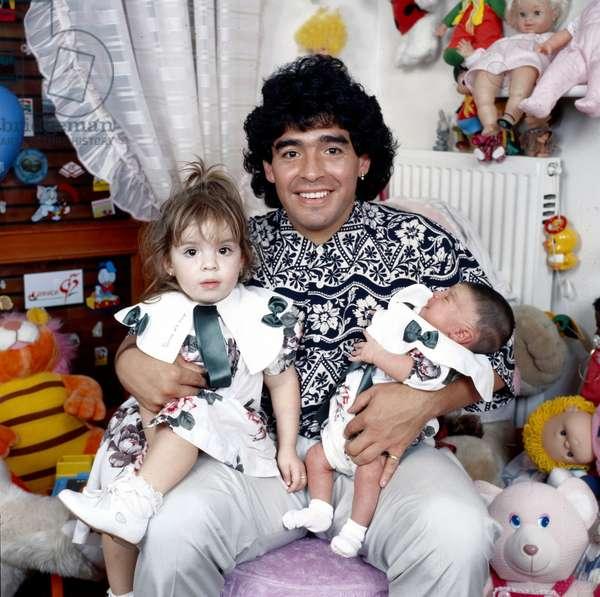 Diego Armando Maradona with his daughters in his arms, Italy