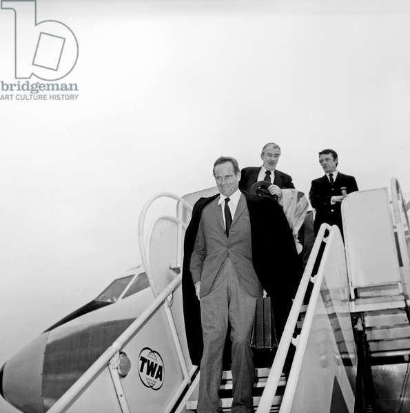 Charlton Heston arriving at Fiumicino Airport, Fiumicino, Italy, 1960 (b/w photo)