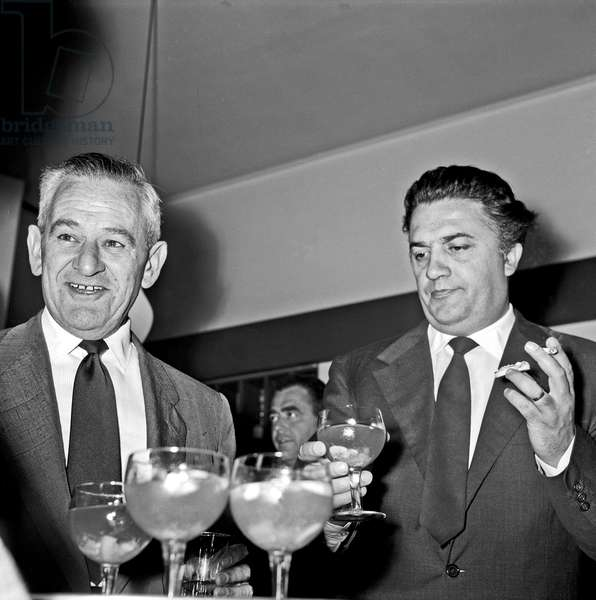 William Wyler and Federico Fellini at the cocktail party for the film 'Ben Hur', Rome, Italy, 1958 (b/w photo)