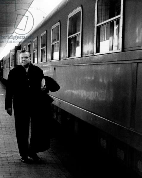 Orson Welles at a station in Rome, 1962 (b/w photo)