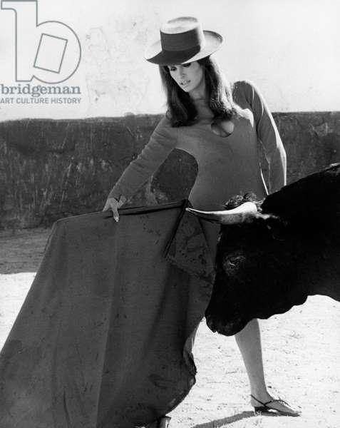 Raquel Welch pretending to be a bullfighter, 1966 (b/w photo)