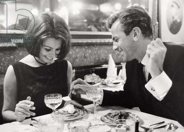 Sophia Loren and Maximilian Schell are having dinner in a restaurant of Hamburg, 1962 (b/w photo)