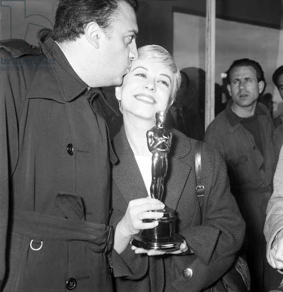 Federico Fellini and Giulietta Masina at Ciampino Airport, Italy, 1957 (b/w photo)