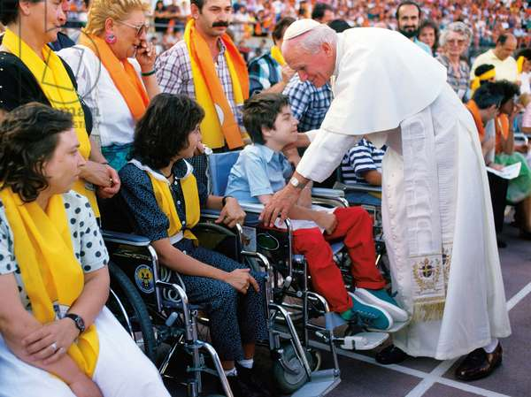 Pope John Paul II with a handicapped boy, Italy