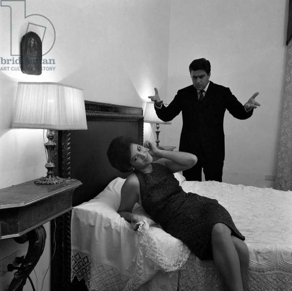 A husband arguing with his wife in the bedroom, Italy