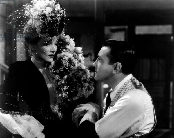 Marlene Dietrich and John Wayne look at each other intensely