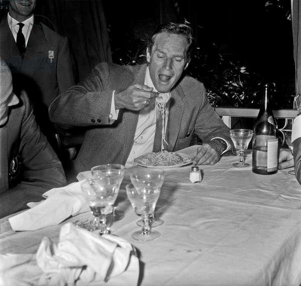 Charlton Heston eating spaghetti, Rome, Italy, 1960 (b/w photo)