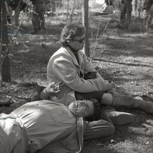 Two members of the crew have a rest during filming of King Vidor's 'War and Peace', 1955 (b/w photo)