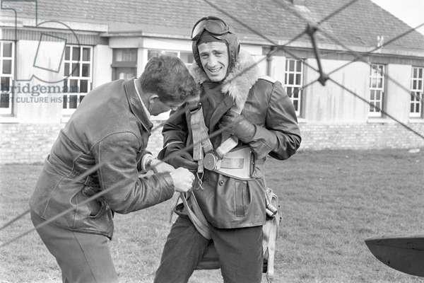 Jean-Paul Belmondo dressed as an aviator on the film set of The Blue Max (b/w photo)