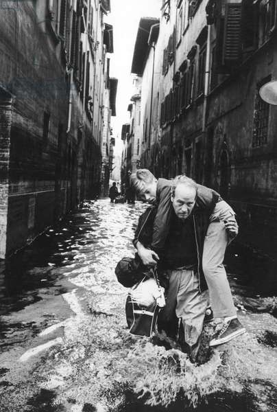 Rescuing during the flood in Florence, Florence, Italy