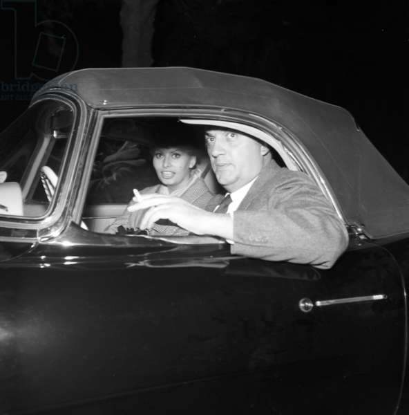 Sophia Loren and Federico Fellini in a car, 1959 (b/w photo)