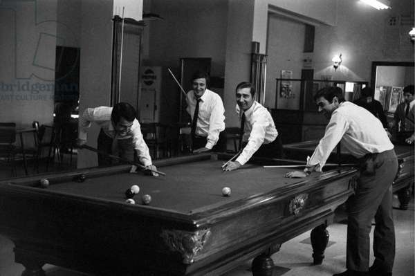 Four friends playing billiards, Italy