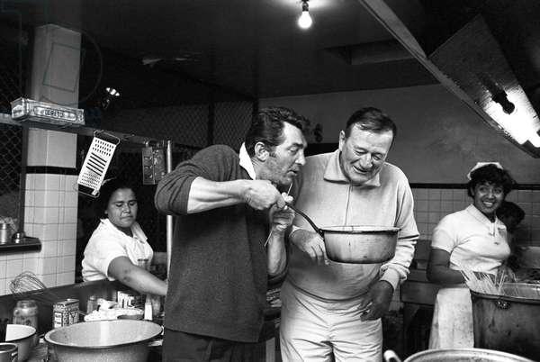 "John Wayne and Dean Martin having a break on the set of the film ""The Sons of Katie Elder"" (b/w photo)"