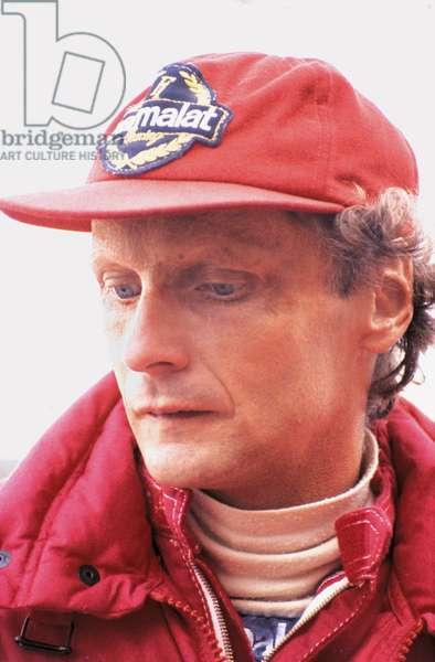 Niki Lauda wearing a cap