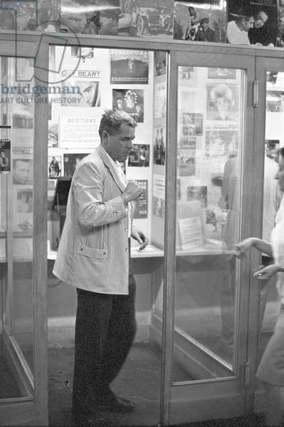 Glenn Ford buying some records (b/w photo)