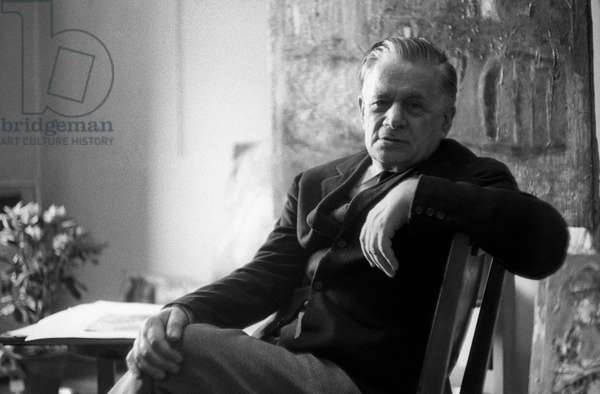 Mario Sironi seated in his atelier, Italy