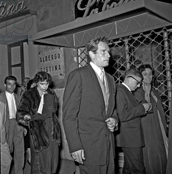 Charlton Heston and his mother Lila Charlton leaving teatro Sistina, Rome, Italy, 1958 (b/w photo)