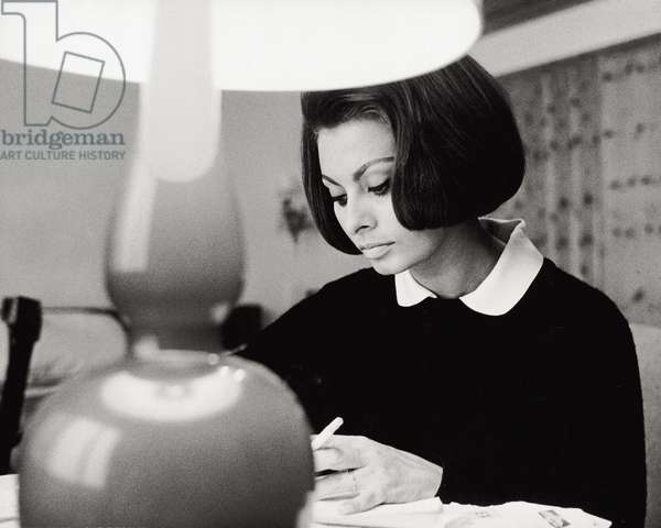 Close-up of Sophia Loren in her lodge in Switzerland, 1963 (b/w photo)