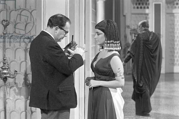 Elizabeth Taylor and Joseph L Mankiewicz on the set of the film 'Cleopatra', 1961 (b/w photo)
