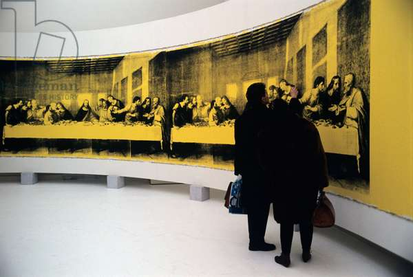 Two people watching the painting The Last Supper by the American artist Andy Warhol (Andrew Warhola Jr.). Milan, 1986