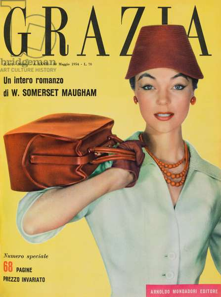 Cover of the women's magazine Grazia, A model wearing garment by Hubert de Givenchy: white canvas suit with a large red leather bag, Vase-shaped red piquè hat by Jean Barthet, May 1954 (b/w photo)
