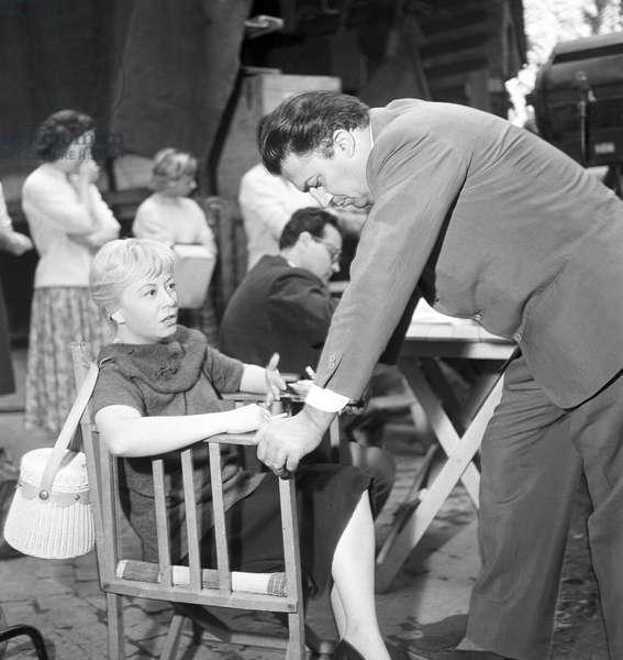 Giulietta Masina and Federico Fellini on the set of the film Fortunella, Italy, 1957 (b/w photo)