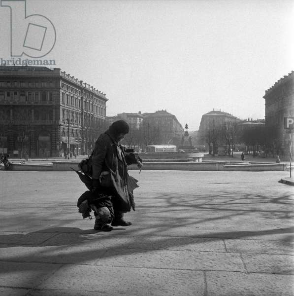 A homeless in piazza Castello,  Milan, Italy