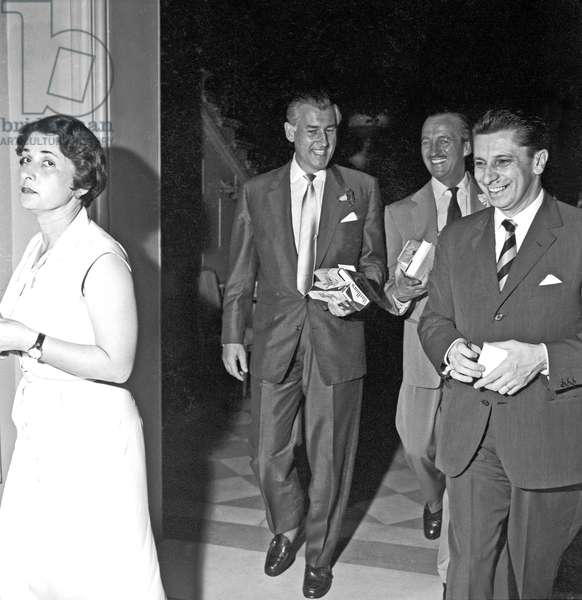 Stewart Granger and David Niven coming out of a hotel, Rome, Italy, 1956 (b/w photo)