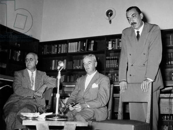 Paolo Milano, William Faulkner and Alberto Mondadori in front of a microphone