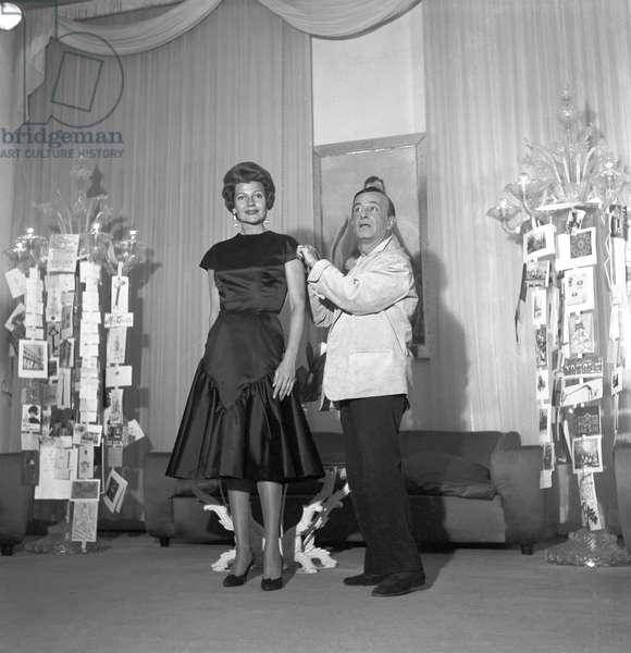 Rita Hayworth with Emilio Federico Schubert in his atelier, Rome, Italy, 1960 (b/w photo)