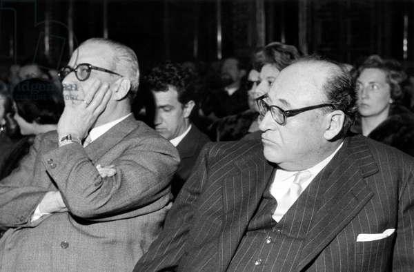 Italian publisher Arnoldo Mondadori sitting in the audience at a meeting, Italy, 1960s (b/w photo)