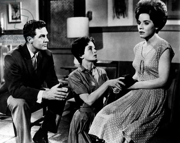 A worried Robert Stack looks at Polly Bergen