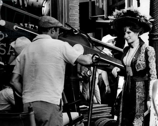 Barbra Streisand and Gene Kelly on the set of Hello, Dolly, 1968 (b/w photo)