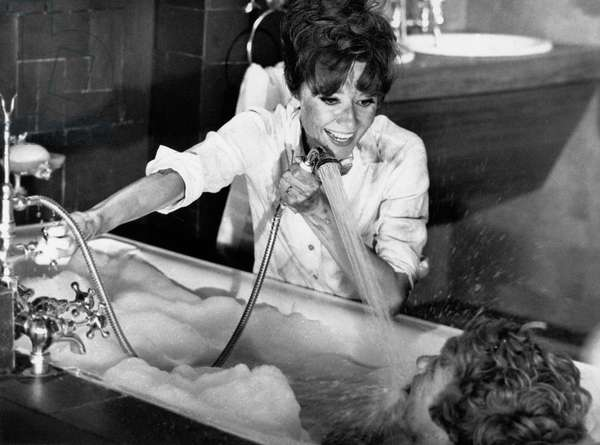Audrey Hepburn joking with Albert Finney in the film Two for the Road, 1967 (b/w photo)