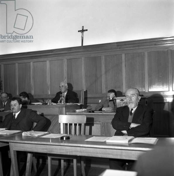 Citizens of Trento and South Tyrol attending a meeting at a polling station during the regional election in Trentino-Alto Adige/Sudtirol, Italy, November 1952 (b/w photo)