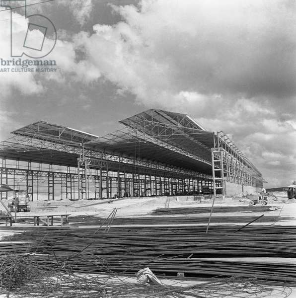 A building site with two iron structures, Caracas, January 1958 (b/w photo)