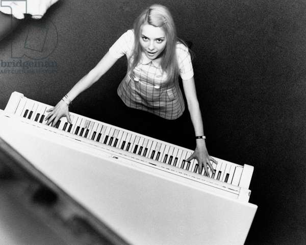 France Gall playing the piano, 1969 (b/w photo)