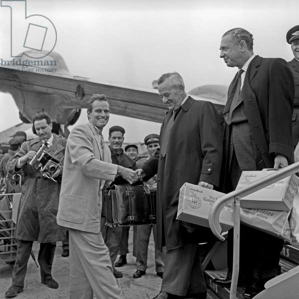 Charlton Heston and William Wyler landing at Ciampino airport, Ciampino, Italy, 1958 (b/w photo)