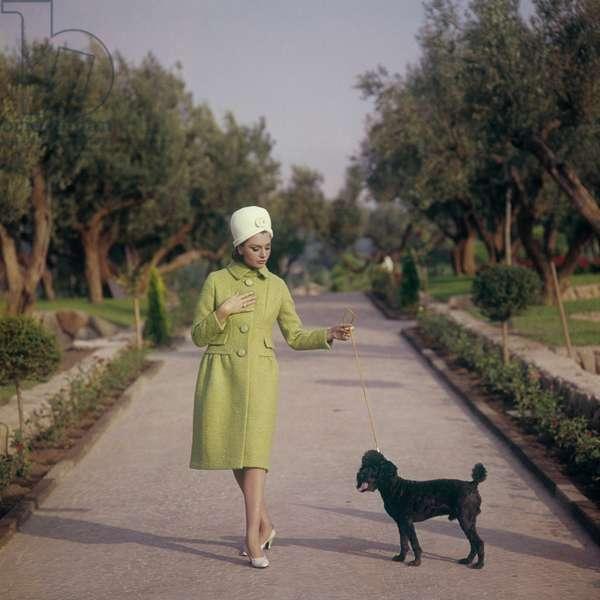 Sylva Koscina walking with a dog