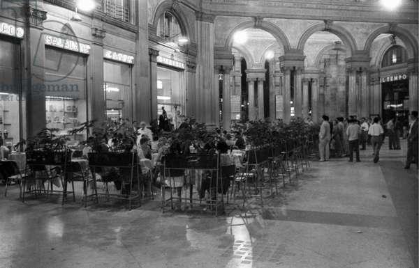 People sitting outside the CaffèBerardo in Rome, Rome, Italy