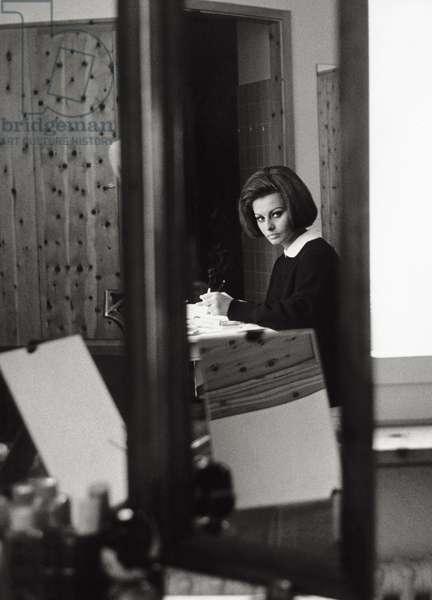 Sophia Loren in her lodge in Switzerland, 1963 (b/w photo)