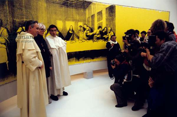 American artist Andy Warhol and two friars photographed in front of his painting The Last Supper. Milan, 1986